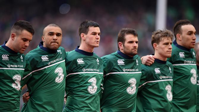 Members of the Ireland team line up before the match