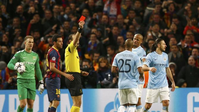 Manchester City's Martin Demichelis is shown the red card to be sent off during their Champions League round of 16 first leg soccer match against Barcelona at the Etihad Stadium in Manchester