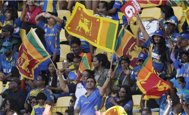 Sri Lanka supporters celebrate during their team's Cricket World Cup match against England in Wellington