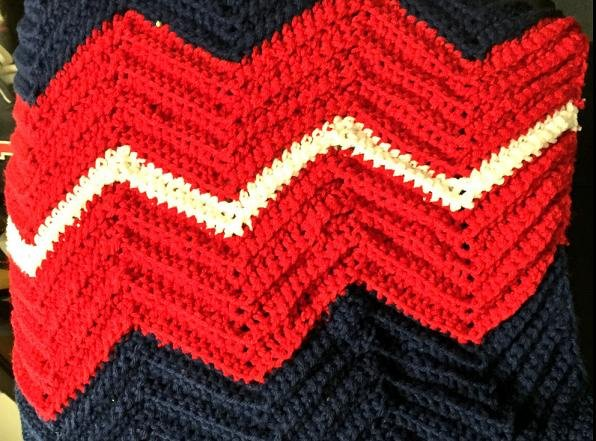 Every Indians player, coach and television broadcaster received a hand-crocheted afghan with the team's colors. (Indians on Twitter)