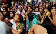 Pakistani women grieve during the funeral of a garment factory fire victim in Karachi. Three factory-owners facing murder charges over the deaths of 289 people in a huge fire in Karachi handed themselves in to court Friday as Pakistan police described the moment the flames took hold
