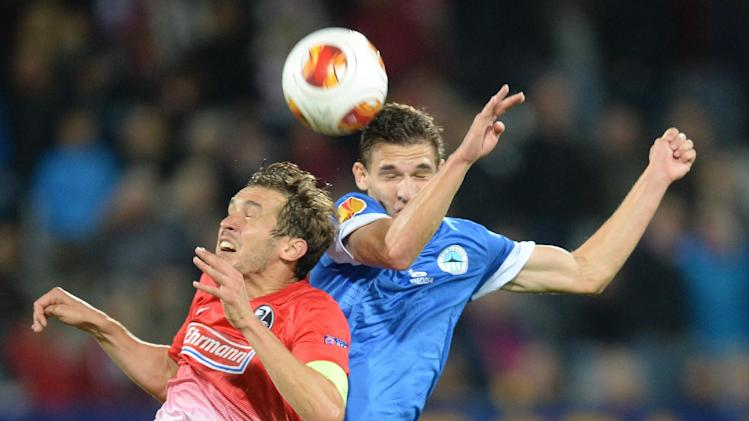 Julian Schuster (, left,  of Freiburg and David Pavelka of Liberec  challenge for the ball during the UEFA Europa League Group H  soccer match between SC Freiburg and Slovan Liberec FC  in Freiburg, Germany,  Thursday Sept. 19, 2013