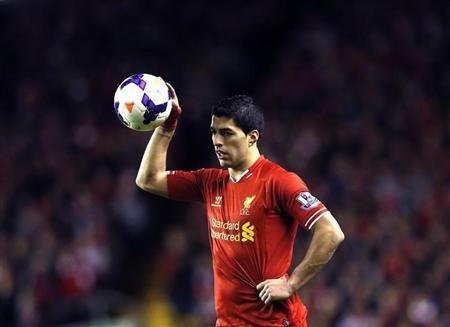 Liverpool's Suarez prepares to take a free kick during their English Premier League soccer match against Sunderland at Anfield in Liverpool