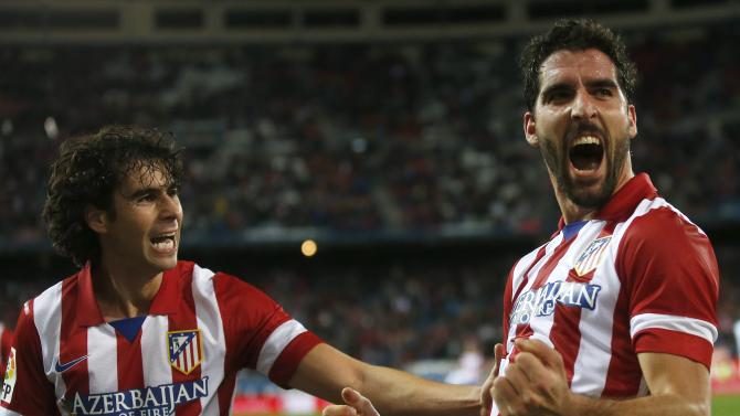 Atletico Madrid's Raul Garcia celebrates a goal with his teammate Tiago Mendes during their Spanish King's Cup soccer match against Valencia in Madrid