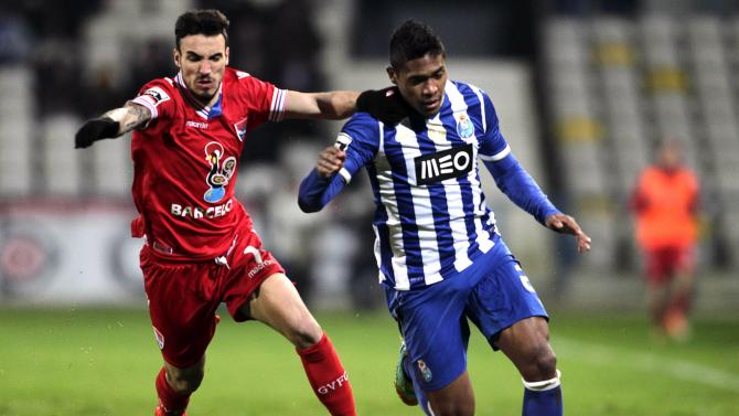 Gil Vicente's Diogo Viana fights for the ball with Porto's Alex Sandro during their Portuguese Premier League soccer match in Barcelos