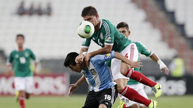 CORRECTS COUNTRIES THAT PLAYERS REPRESENT - Mexico's Pedro Teran, top and Argentina's Luis Leszczuk fight for the ball during the World Cup U-17 semifinal soccer match at Mohammad Bin Zayed stadium in Abu Dhabi, United Arab Emirates, Tuesday, Nov. 5, 2013