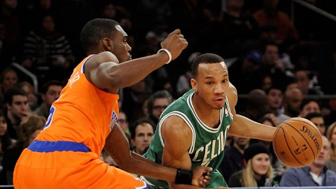 Boston Celtics' Avery Bradley right,  drives the ball around New York Knicks' Tim Hardaway Jr.  during the second half of an NBA basketball game on Sunday, Dec. 8, 2013, in New York. The Celtics won 114-73