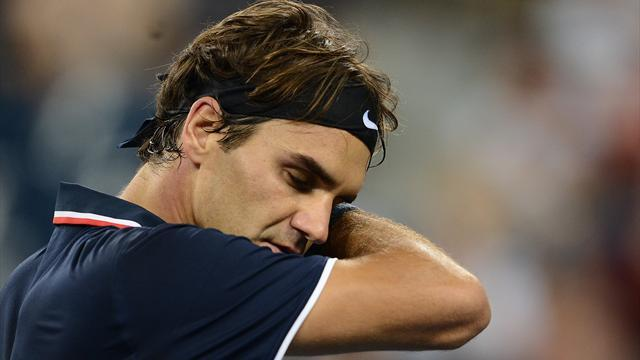 'Wounded' Federer wants break from tennis