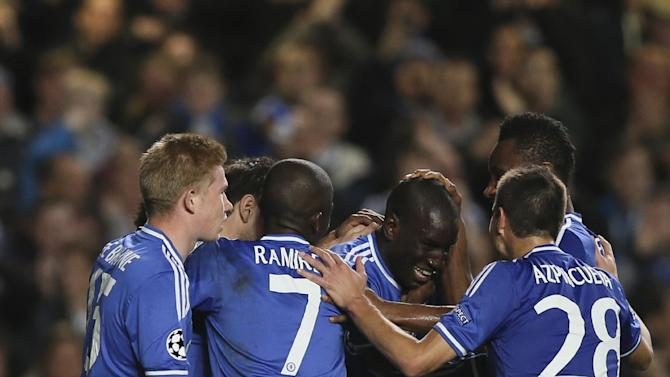Team mates congratulate goal scorer Chelsea's Demba Ba during the Champions League group E soccer match between Chelsea and FC Schalke 04 at Stamford Bridge stadium in London, Wednesday, Nov. 6, 2013