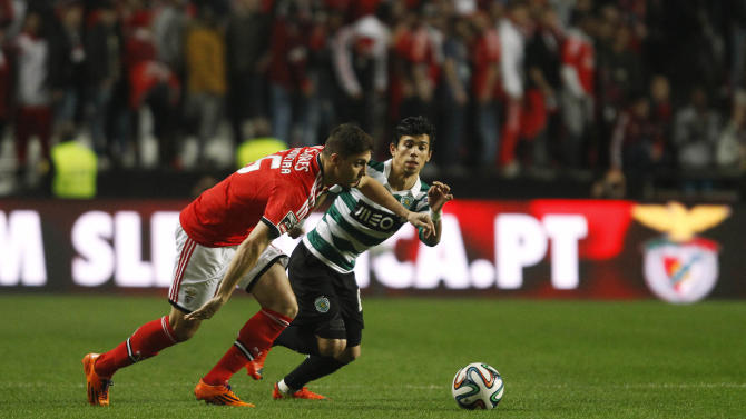 Benfica's Guilherme Siqueira fights for the ball with Sporting's Andre Martins during their Portuguese Premier League soccer match at Luz stadium in Lisbon