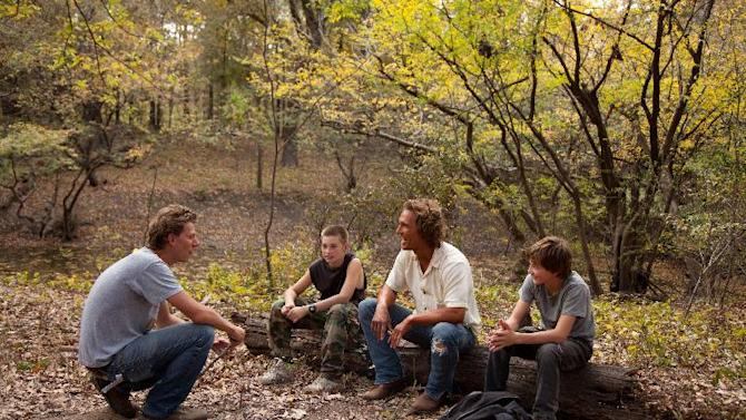"This film publicity image released by Roadside Attractions shows director Jeff Nichols, from left, with actors, Tye Sheridan, Matthew Mc Conaughey and Jacob Lofland on the set of ""mud."" Nichols fashions a Mark Twain-esque Mississippi River tale with some big Hollywood names, including Matthew Mc Conaughey and Reese Witherspoon. (AP Photo/Roadside Attractions, Jim Bridges)"