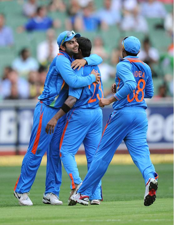 India's Ranganath Vinay Kumar, center, celebrates with a teammates after taking the wicket of Australia's  Ricky Ponting during their one cay international cricket match at the MCG in Melbourne, Austr