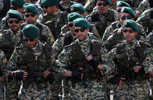 Iranian soldiers take part in a military parade in Tehran, on April 18, 2014