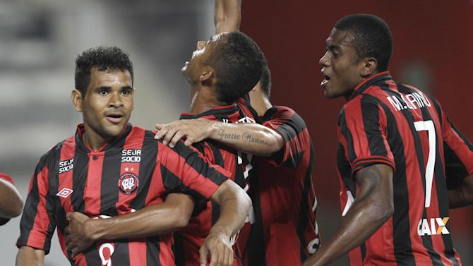 Ederson of Brazil's Atletico Paranaense, left, celebrates teammates after scoring against Peru's Sporting Cristal during a Copa Libertadores soccer match in Lima, Peru, Wednesday, Jan. 29, 2014
