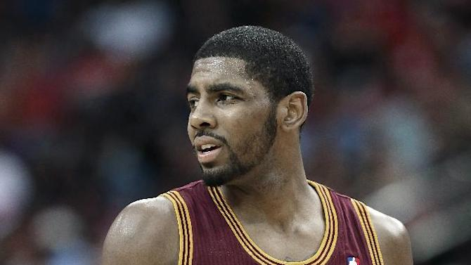 Cleveland Cavaliers' Kyrie Irving looks back at the referee after being called for a foul against the Houston Rockets in the second half of an NBA basketball game Saturday, Feb. 1, 2014, in Houston. The Rockets won 106-92