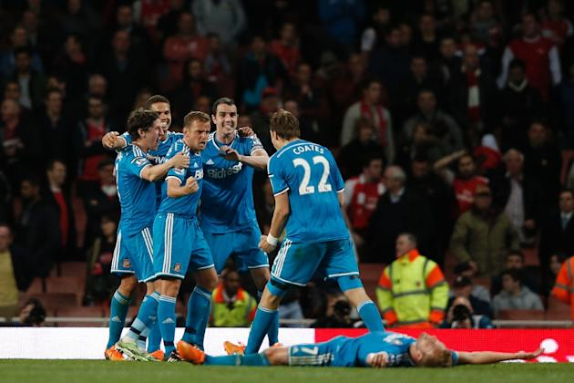 Sunderland's players celebrate at the final whistle of their English Premier League goalless draw with Arsenal, at the Emirates Stadium in London, on May 20, 2015