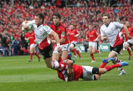 Ulster's Craig Gilroy runs in for a try against Munster's Tommy O'Donnell (right)