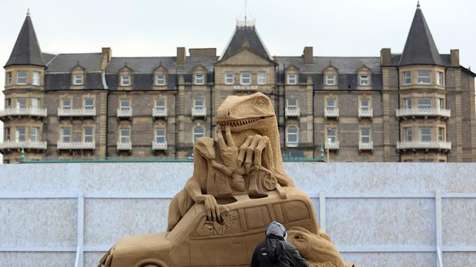 Sculptors Place The Finishing Touches To Their Hollywood Themed Sand Sculptures