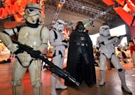 Darth Vader and Storm Troopers pose for visitors for the demonstration of the Star Wars videogame at the annual Tokyo Game Show. Sophisticated gameplay and cheap downloads that are fuelling a boom in software for smartphones and tablets were on display Thursday at the Tokyo Game Show, the biggest of its kind in Asia