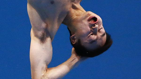 China's Qin Kai performs a dive during the men's 3m springboard final at the London 2012 Olympic Games at the Aquatics Centre