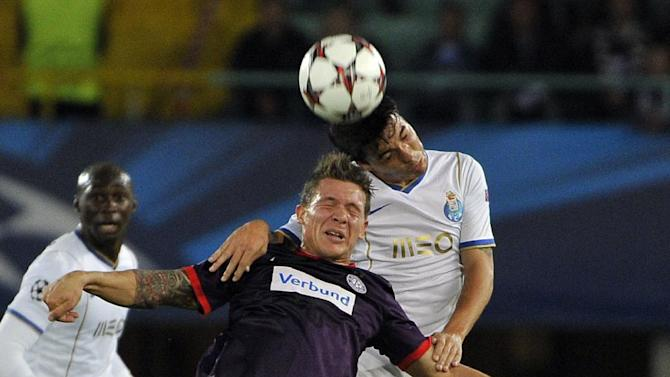 Austria's Marko Stankovic, left, and Porto's, Josue challenge for the ball during the Champions League first round group G soccer match between FK Austria Vienna and FC Porto in Vienna, Austria, Wednesday, Sept. 18, 2013