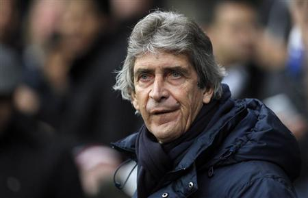 Manchester City's manager Pellegrini watches the start of their FA Cup third round match against the Blackburn Rovers at Ewood Park in Blackburn, northwest England