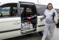 Desaree Rush of Charleston loads up her van with water containers after making a water pick up for the elderly residents in her neighborhood in Charleston, West Virginia, January 11, 2014.. REUTERS/Lisa Hechesky