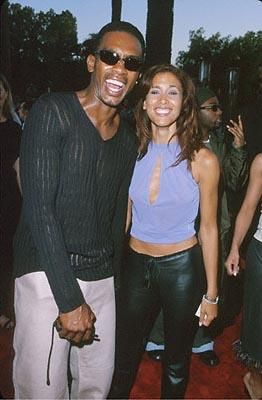 Premiere: Bill Bellamy and a woman with shiny black pants at the Universal City premiere of Universal's Nutty Professor II: The Klumps - 7/24/2000