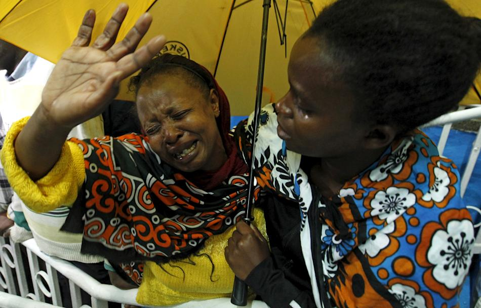A woman reacts after seeing her son who was rescued from the Garissa University attack in Nairobi, following Thursday's seige by gunmen in their campus in Garissa