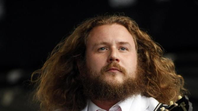 "FILE - This July 28, 2012 file photo shows Jim James performing at the Newport Folk Festival in Newport, R.I. James thinks music is a spiritual force that can unite humanity. He's taking that message _ and his new album ""Regions of Light and Sound of God"" _ to the South By Southwest Music Festival this week. (AP Photo/Joe Giblin, file)"