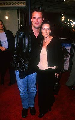 Matthew Perry with lady at the Mann Village Theater premiere of Warner Brothers' Three Kings