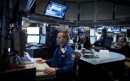 Traders work on the floor of the New York Stock Exchange at the opening bell in New York, January 2, 2014. REUTERS/Carlo Allegri