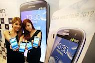 This photo, released by Samsung on June 25, shows South Korean models holding the company's latest smartphone, the Galaxy S3, during its unveiling ceremony for the domestic market in Seoul. Samsung Electronics, the world's largest smartphone maker, said it expects to have sold 10 million of its Galaxy S3 model by the end of July, two months after its launch