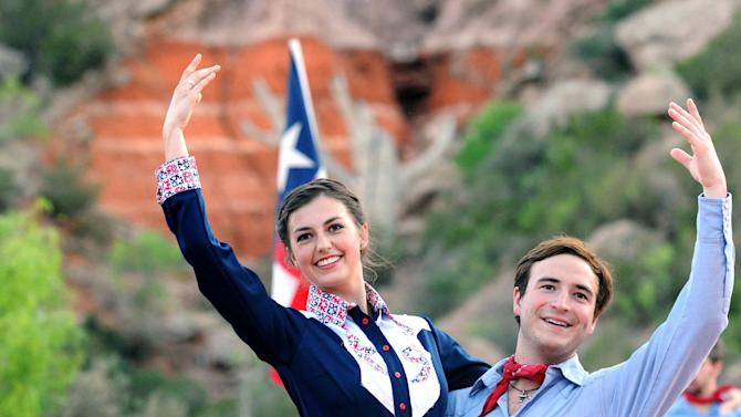 "In this May 21, 2013 photo, ""Texas"" cast members Alexia Valente, left and Clint Diaz rehearse on stage at the Pioneer Amphitheatre in Palo Duro Canyon, Texas. Five cast members of the musical were killed in an automobile accident Monday night, Aug. 12, 2013 near Dumas, Texas, said Christopher Ray, a Texas Department of Public Safety spokesman. (AP Photo/Amarillo Globe-News, Sean Steffen)"