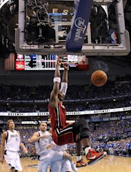 Miami Heat's Chris Bosh dunks during the second half of Game 3 of the NBA Finals basketball game against the Dallas Mavericks Sunday, June 5, 2011, in Dallas. The Heat won 88-86 take a 2-1 lead in the series.