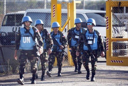 UN peacekeepers from the Philippines head for the Israeli annexed Golan Heights from the Quneitra crossing on June 12, 2013. President Benigno Aquino threatened to withdraw Philippine troops from the UN peacekeeping force on the Golan Heights unless they receive anti-tank and anti-aircraft weapons, and are protected against chemical arms