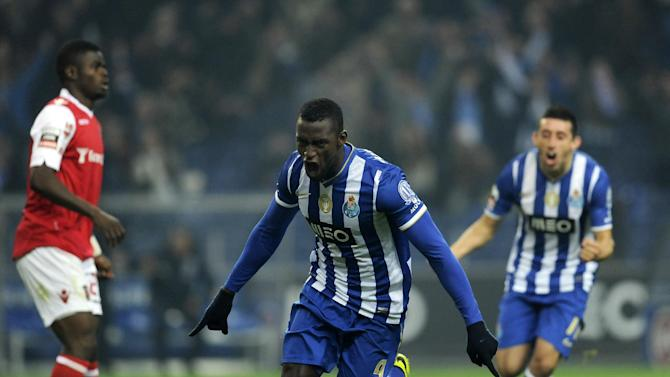 FC Porto's Jackson Martinez, from Colombia, center, celebrates with Hector Herrera from Mexico, rear, after scoring the opening goal against Sporting Braga in a Portuguese League soccer match at the Dragao Stadium in Porto, Portugal, Saturday, Dec. 7, 2013