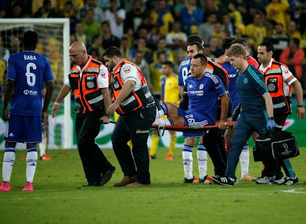 Chelsea's John Terry (C) is carried off the pitch on a stretcher during the UEFA Champions League, group G, match against Maccabi Tel Aviv on November 24, 2015
