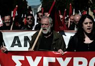 Demonstrators shout slogans during a 24-hour general strike in Athens on February 20, 2013. Successive cuts to salaries and pensions over the past three years have angered Greeks who have frequently taken to the streets to demonstrate their frustration
