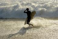 This file illustration photo shows a surfer at Injidup Beach, in the south-west corner of Western Australia. A surfer was apparently bitten to death by a shark off Australia's west coast on Saturday, police said, the fifth such fatal attack in the region in less than a year