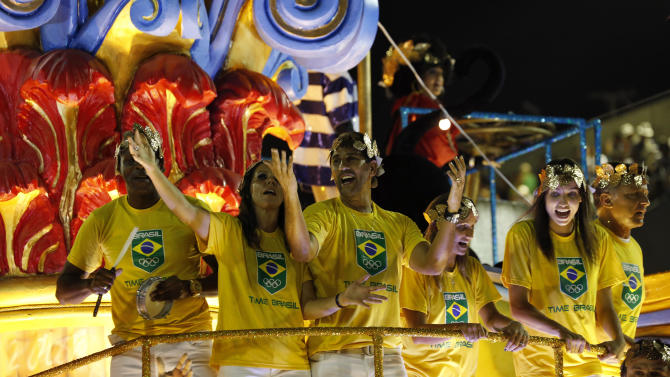 Beach volleyball player Pires and volleyball player Lima parade with the Uniao da Ilha samba school during the carnival parade at the Sambadrome in Rio de Janeiro