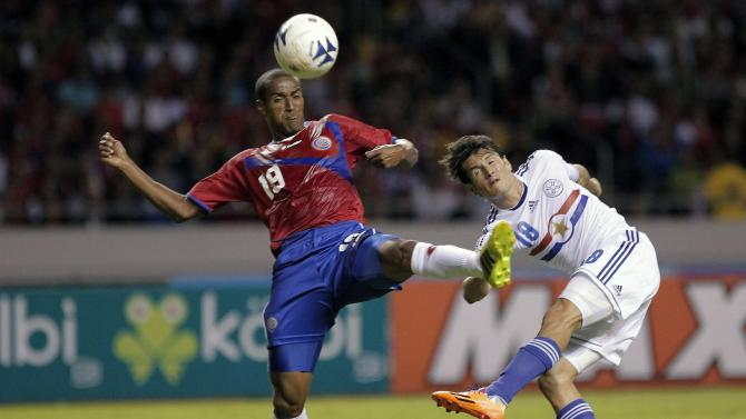 Paraguay's Haedo fights for the ball with Costa Rica's Miller during their international friendly soccer match at the National stadium in San Jose