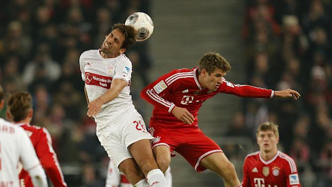 Stuttgart's Rani Khedira, left, and Bayern's Thomas Mueller challenge for the ball during a German first soccer division Bundesliga match between VfB Stuttgart and FC Bayern Munich in Stuttgart, Germany, Wednesday, Jan. 29, 2014