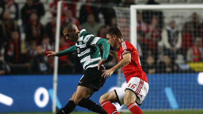 Benfica's Guilherme Siqueira fights for the ball with Sporting's Islam Slimani during their Portuguese Premier League soccer match at Luz stadium in Lisbon