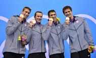 L-R: US swimmers Matthews Grevers, Brendan Hansen, Michael Phelps and Nathan Adrian pose on the podium with the gold medal after winning the men's 4x100 medley relay final during the swimming events at the London 2012 Olympic Games