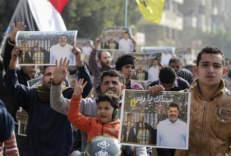 """Supporters of the Muslim Brotherhood and ousted Egyptian President Mohamed Mursi protest against the military and interior ministry, while making the four-finger Rabaa gesture, at Nasr City district in Cairo January 3, 2014. The """"Rabaa"""" or """"four"""" gesture is in reference to the police clearing of the Rabaa al-Adawiya protest camp on August 14, 2013. REUTERS/ Mohamed Abd El Ghany"""