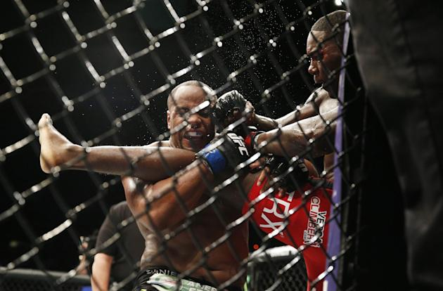 Daniel Cormier, left, engages with Anthony Johnson during their light heavyweight title mixed martial arts bout at UFC 187 Saturday, May 23, 2015, in Las Vegas. (AP Photo/John Locher)