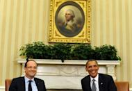 US President Barack Obama (R) and French President Francois Hollande smile during a bilateral meeting in the Oval Office. The two mean firmly agreed on the need for strong pro-growth policies to loosen an austerity straitjacket, ahead of a G8 summit darkened by the eurozone crisis