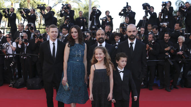 Producer Alexandre Mallet-Guy, left, actress Berenice Bejo, director Asghar Farhadi, second from right in back, actor Ali Mosaffa, back right, actress Jeanne Jestin, front left, and actor Elyes Aguis, front right, pose for photographers as they arrive for the awards ceremony of the 66th international film festival, in Cannes, southern France, Sunday, May 26, 2013. (Photo by Joel Ryan/Invision/AP)