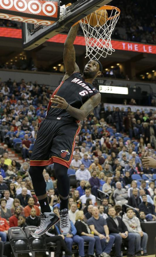 Miami Heat forward LeBron James (6) dunks the ball during the first quarter of an NBA basketball game against the Minnesota Timberwolves  in Minneapolis, Saturday, Dec. 7, 2013. James had a game-high 21 points as the Heat won 103-82